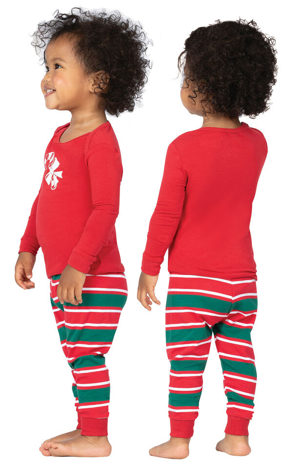 Model wearing Red and Green Christmas Stripe PJ for Infants, facing away from the camera and then to the side image number 1