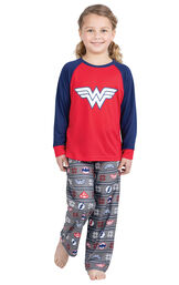 Model wearing Red and Blue Justice League PJ - Kids