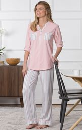 Model standing in kitchen wearing Pink Henley PJ with Striped Pants for Women image number 6