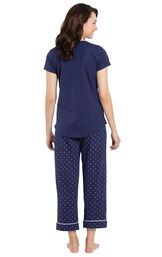 Model wearing Navy and White Short Sleeve Capri PJ for Women, facing away from the camera image number 1