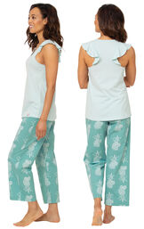 Model wearing Margaritaville Easy Island Capri PJs - Turquoise Pineapple, facing away from the camera and then facing to the side image number 1