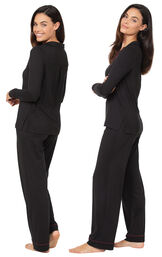 Model wearing Midnight Fantasy Pajamas - Black, facing away from the camera and then facing to the side image number 1
