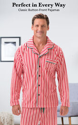 Model wearing Candy Cane Fleece Men's Pajamas by a chair with the following copy: Perfect in Every Way, Classic Button-Front Pajamas image number 2