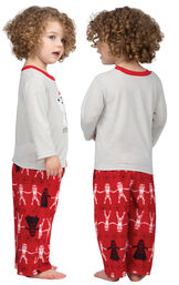 Model wearing Red Star Wars PJ for Toddlers, facing away from the camera and then to the side image number 1