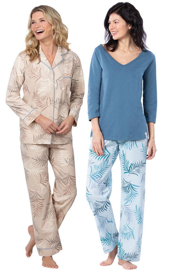 Models wearing Margaritaville Palm Frond Boyfriend Pajamas - Sand and Margaritaville Tropical Dreams Pajamas - Blue. image number 0