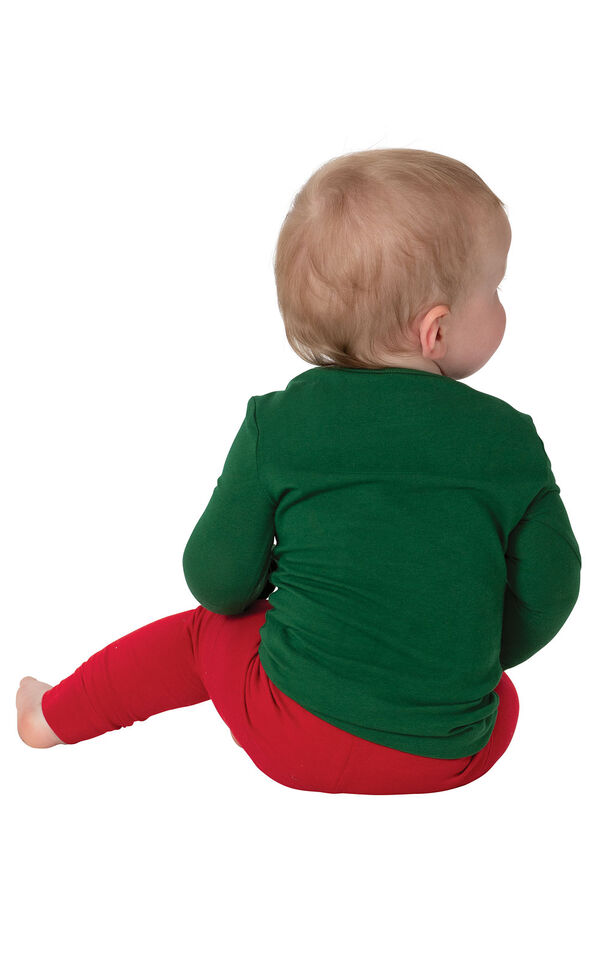 Model wearing red and green holiday argyle infant pajamas, facing away from the camera image number 1