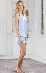 Model standing to the side wearing Light Blue with Pink Trim Dreamy Satin Short Set image number 3