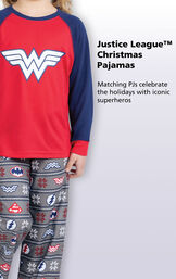 Close-up of Red and Blue Justice League Girls PJ Wonder Woman Top with the following copy: Matching PJs celebrate the holidays with iconic superheroes image number 2