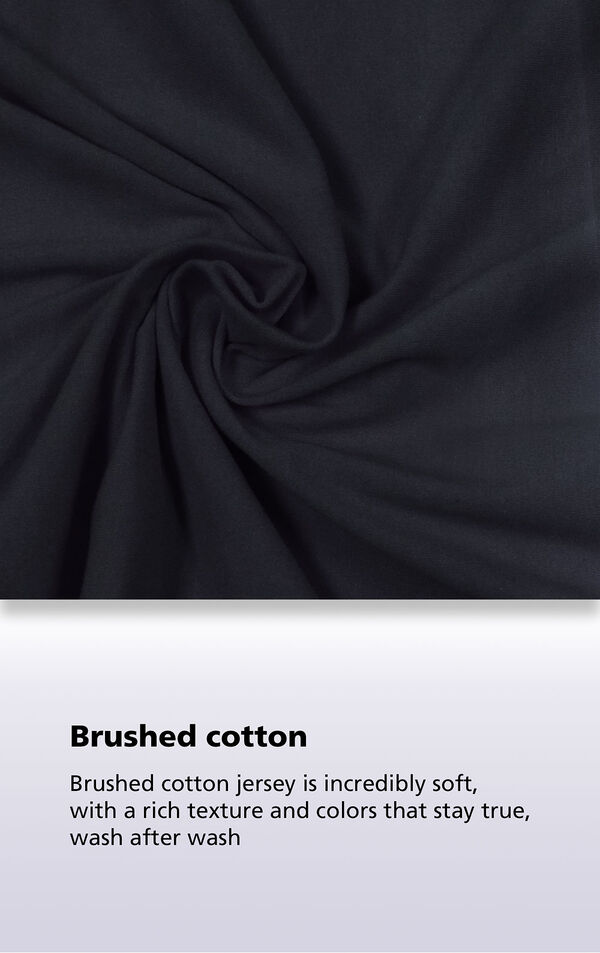 Black fabric with the following copy: our oh-so-soft collection gets softer with each wash image number 4