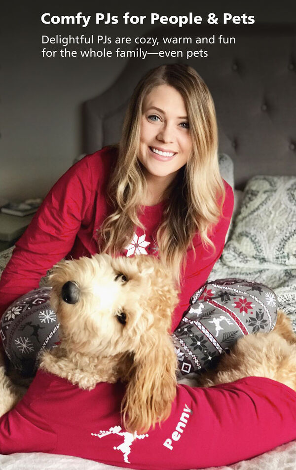 Customer Photo of woman and dog sitting on bed wearing matching Nordic pajamas. Delightful PJs are cozy, warm and fun for the whole family - even pets. image number 2