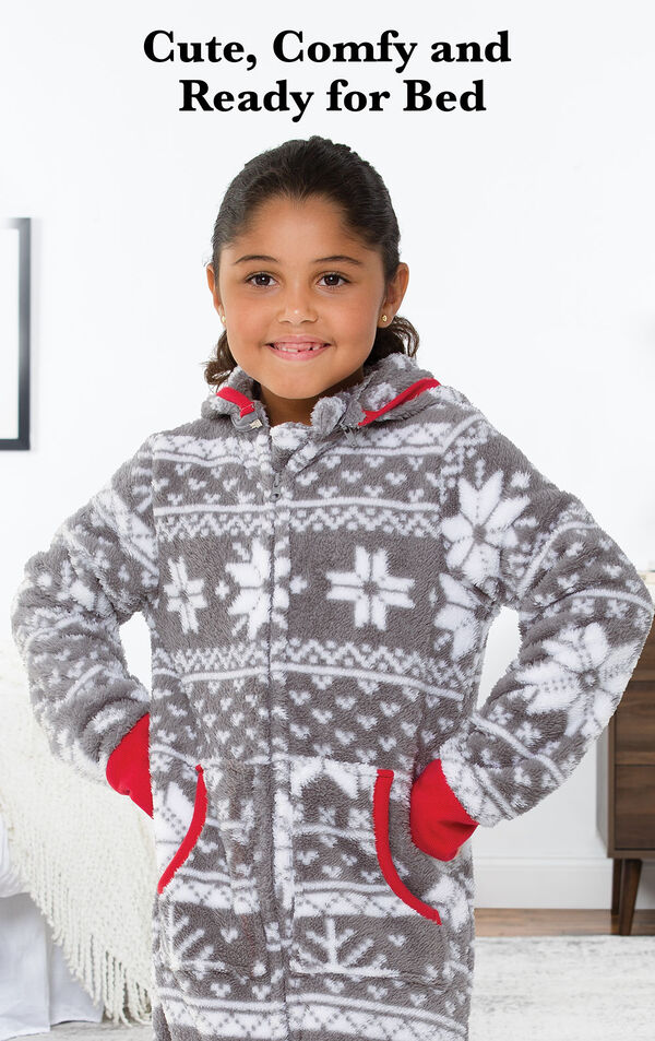 Girl wearing Nordic Fleece Hoodie-Footie by bed with the following copy: Sweet Dreams Start with PajamaGram. image number 1