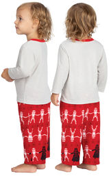 Model wearing Red Star Wars PJ for Infants, facing away from the camera and then to the side image number 1