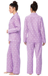 Model wearing Lavender Dot Flannel Button-Front PJ for Women, facing away from the camera and then to the side image number 1