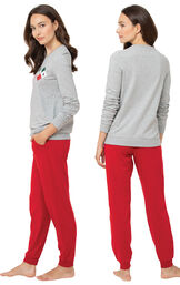 Model wearing Gray and Red Holiday Argyle Women's Pajamas, facing away from the camera and then facing to the side image number 1