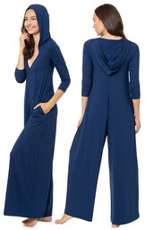 Model wearing Navy Blue Jumpsuit PJs for Women, facing away from the camera and then facing to the side image number 1