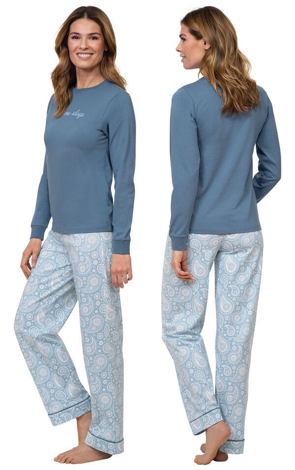 """Model wearing Blue Long-sleeve top with """"Let me sleep"""" graphic paired with Blue and White Paisley Full-length pants, facing away from the camera and then to the side image number 1"""