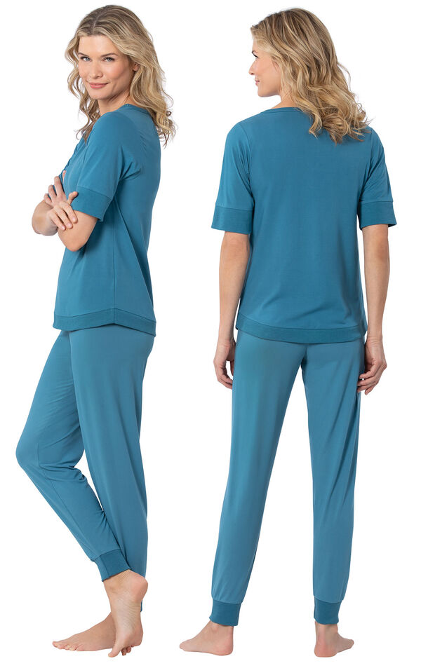 Model wearing Teal Jogger Pajamas for Women, facing away from the camera and then to the side image number 1