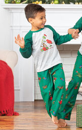 Boy playing with siblings wearing Green and Gray Dr. Seuss The Grinch Boys Pajamas image number 2