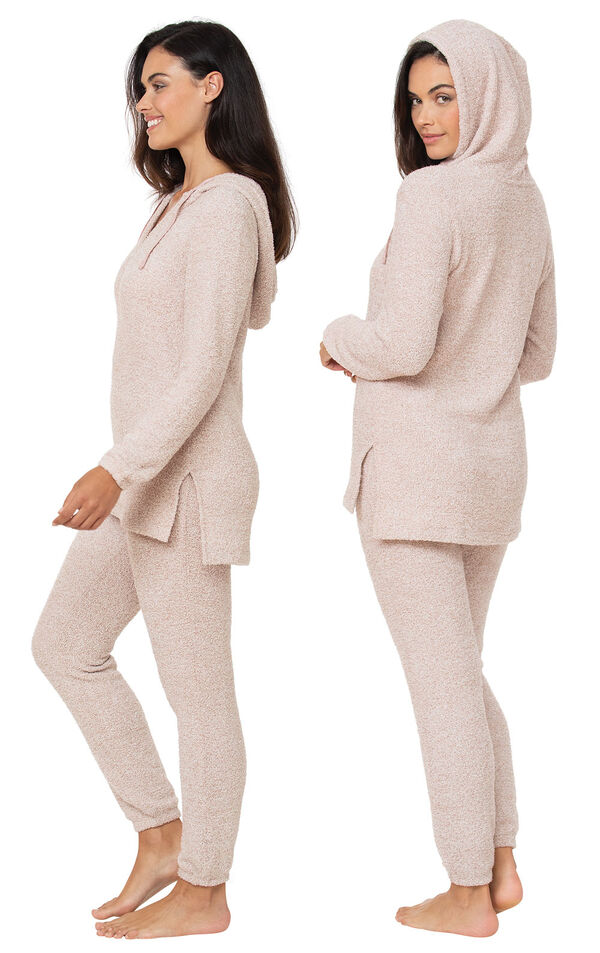 Model wearing Cozy Escape Pajamas - Pink facing away from the camera and then facing to the side image number 1