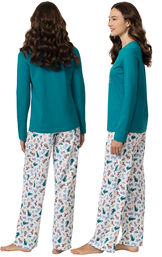 """Model wearing Teal and White """"Dogs are my favorite people"""" Pajamas, facing away from the camera and then to the side image number 1"""