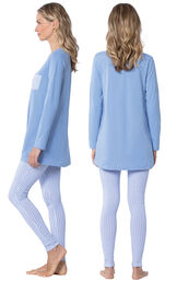 Model wearing Long Sleeve and Legging Pajamas - Light Blue, facing away from the camera and then to the side image number 1