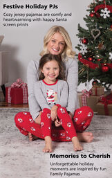Mother and Daughter wearing St. Nick Matching Family Pajamas with the following copy: Festive Holiday PJs - cozy jersey pajamas are comfy and heartwarming with happy Santa screen prints. Memories to cherish - Unforgettable holiday moments are inspired by  image number 2
