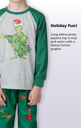 Close-up of Dr. Seuss' The Grinch PJ Long-Sleeve Top with the following copy: Holiday fun! Long-sleeve jersey pajama top is cozy and warm with a festive Grinch graphic. image number 3