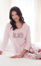 "Model sitting on bed wearing Pink and Red ""I Love Lucy"" Chocolate Factory Pajamas image number 4"