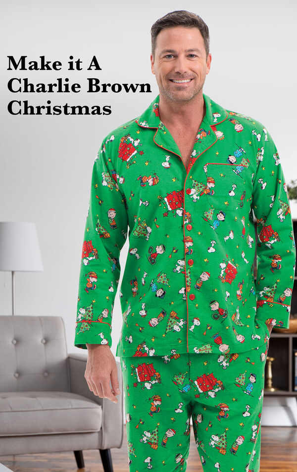 Model wearing Charlie Brown Christmas Men's Pajamas by a couch with the following copy: Make it A Charlie Brown Christmas image number 2