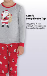 Close-up of St. Nick PJs Comfy Long-Sleeve Top with the following copy: Cozy jersey PJ top with cuffed long sleeves features Santa Graphic image number 2