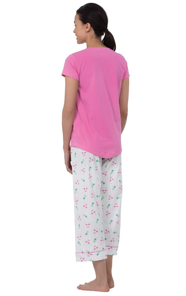 Model wearing Pink and White Flamingo Capri PJ for Women, facing away from the camera image number 1