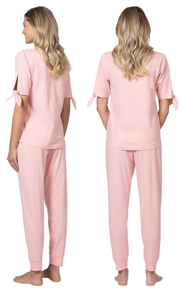 Model wearing Pink Tie Sleeve Jogger PJ for Women, facing away from the camera and then to the side image number 1