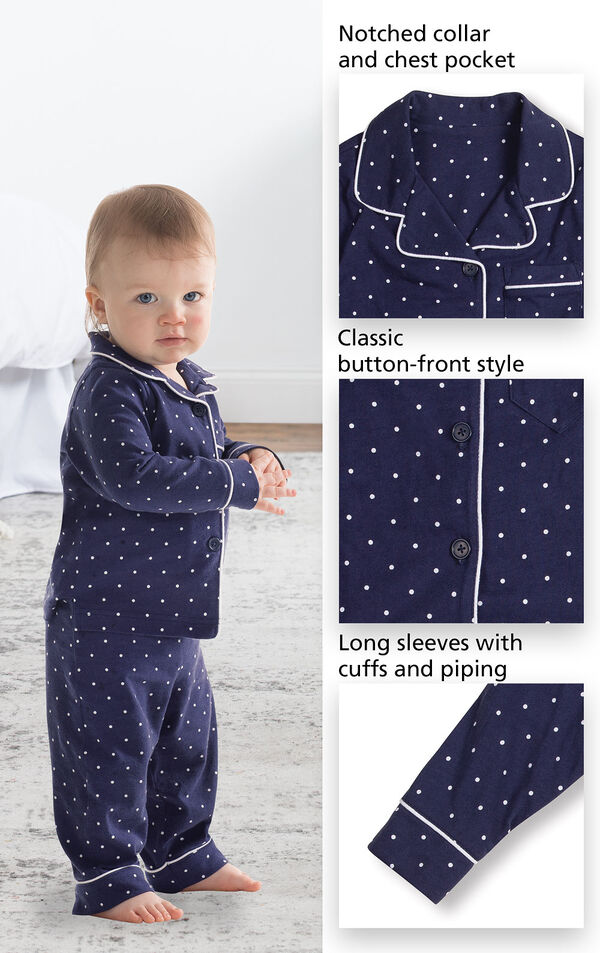 Close-ups of Classic Polka-Dot Infant Pajamas - Navy features which  include a notched collar and chest pocket, classic button-front style and long sleeves with cuffs and piping image number 2