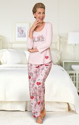 "Model standing by bed wearing Pink and Red ""I Love Lucy"" Chocolate Factory Pajamas image number 3"