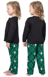 Model wearing Black and Green Snowman Argyle Henley PJ for Toddlers, facing away from the camera and then to the side image number 1
