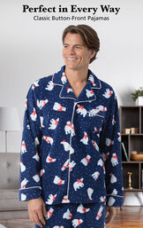 Model wearing Polar Bear Fleece Men's Pajamas by a couch with the following copy: Perfect in Every Way - Classic Button-Front Pajamas image number 2