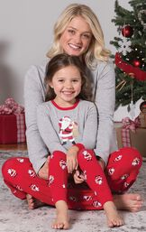 Mom and Toddler wearing matching gray and red St. Nick Pajamas, sitting by Christmas Tree image number 2