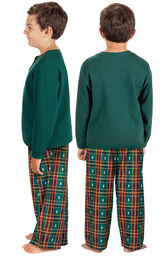Model wearing Red and Green Christmas Tree Plaid Thermal Top PJ for Kids, facing away from the camera and then to the side image number 1