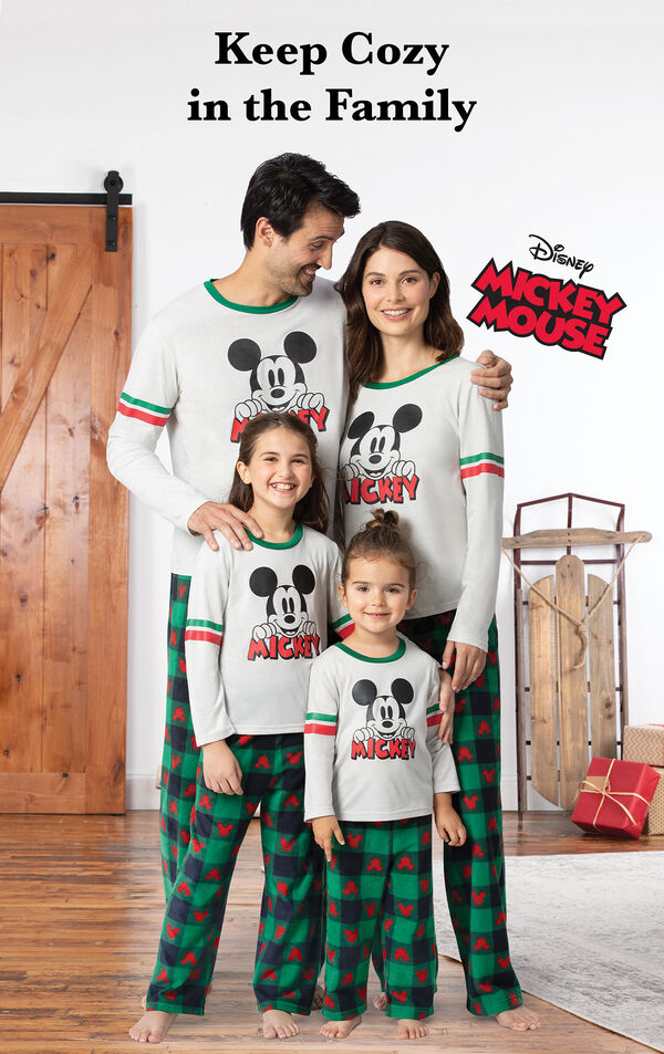 Family wearing Red and Green Mickey Mouse Holiday Pajamas with the Disney logo and the following copy: Keep Cozy in the Family image number 1