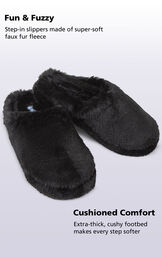 Black Fuzzy Wuzzies slippers with the following copy: step-in slippers made of super-soft faux fur fleece. Extra-thick, cushy footbed makes every step softer image number 1