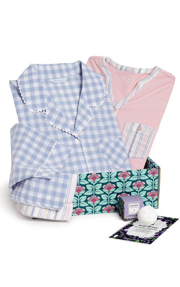 Periwinkle Blue Gingham Boyfriend PJs & Pink and Blue striped Henley PJs in a blue and pink floral box with a bath bomb image number 0