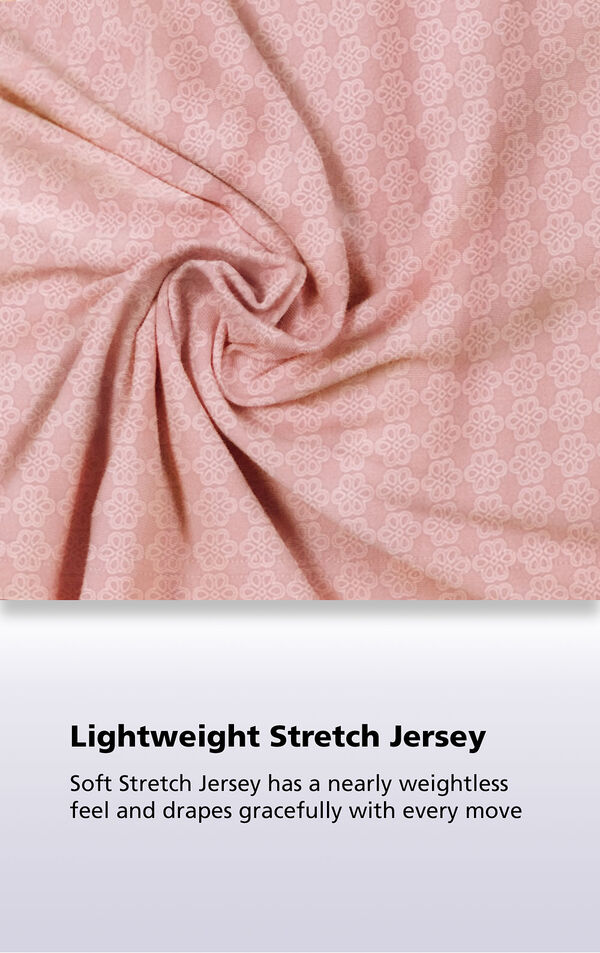 Pink Geometric Print fabric with the following copy: Soft stretch jersey has a nearly weightless feel and drapes gracefully with every move image number 5