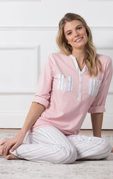 Model sitting down wearing Pink Henley PJ with Striped Pants for Women image number 3