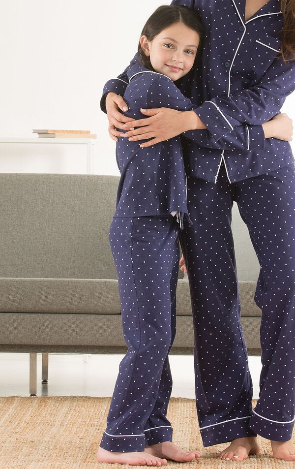 Mother and daughter wearing matching Navy Blue with White Dots Classic Polka-Dot Pajamas image number 1