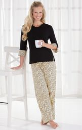 Model wearing Leopard Print PJ - Black for Women holding a cup of coffee image number 3