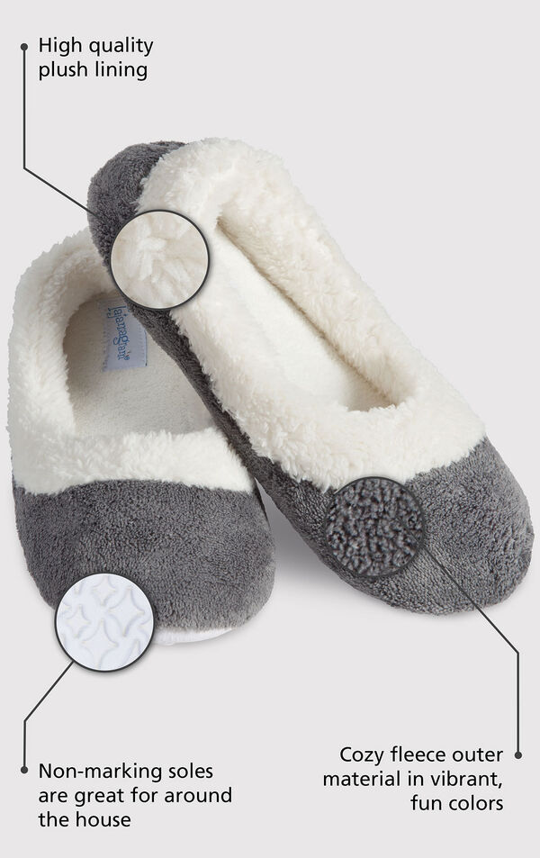 Close up of the Gray World's Softest Slipper with the following copy: High quality plush lining adds warmth and a touch of glamour. Non-marking soles are great for around the house. The softest pile fleece and an extra-padded footbed image number 1