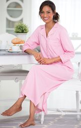 Model sitting at kitchen table wearing Oh-So-Soft Pin Dot Nighty - Pink image number 2