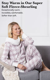 Model sitting on a couch wearing Chalet Shearling Rollneck Pajamas with the following copy: Stay warm in our Super-Soft Fleece-Shearling. Exceptionally warm, incredibly comfortable, softer than soft. image number 3