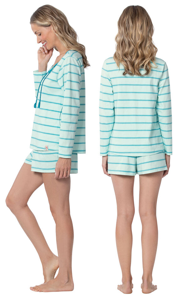 Model wearing Blue Margaritaville Long Sleeve Striped Short Set for Women, facing away from the camera and then to the side image number 1