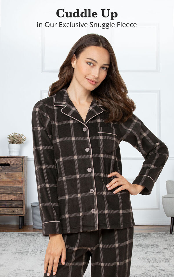 Model standing in bedroom wearing Charcoal Check Fleece PJs with the following copy: Cuddle Up in our exclusive Snuggle Fleece image number 2
